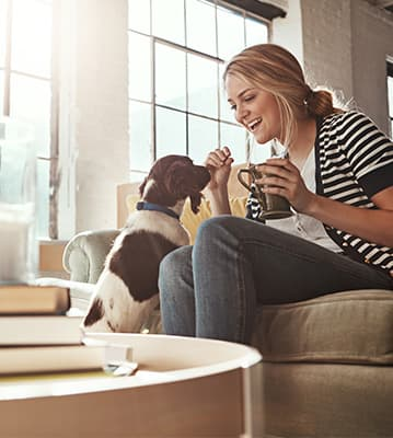woman and her dog enjoying morning together.